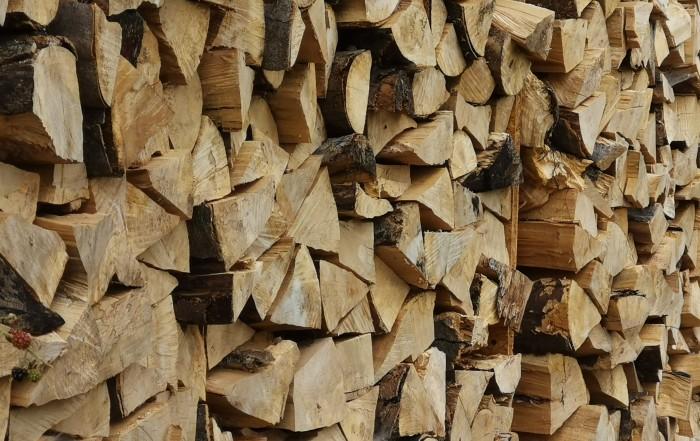 brown wooden log lot during daytime